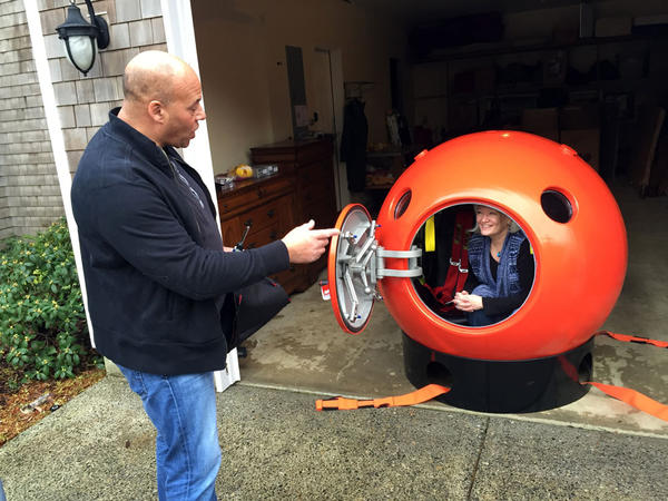 Survival Capsule President Julian Sharpe gives some tips to his first domestic U.S. customer Jeanne Johnson.