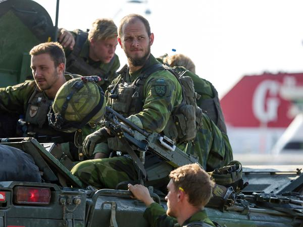 A combat team deploys in Visby harbour in Sweden last year. Sweden's Baltic Sea island of Gotland is once again home to a permanent military presence, amid speculation over the country's ability to defend itself against a more assertive Russia.