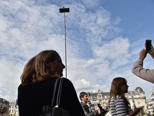Poincheval sits on a platform placed atop a roughly 60-foot-high pole, as part of his performance outside the Gare de Lyon railway station in Paris last year.
