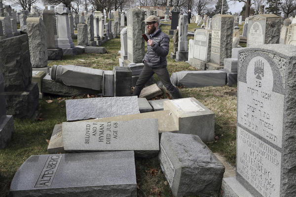 Rabbi Joshua Bolton of the University of Pennsylvania's Hillel center surveys damaged headstones at Mount Carmel Cemetery  in Philadelphia. (Jacqueline Larma/AP)
