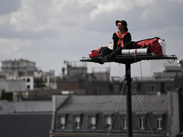 Poincheval looks on, nestled among his things atop a platform about 60 feet above the ground in Paris, in September 2016.