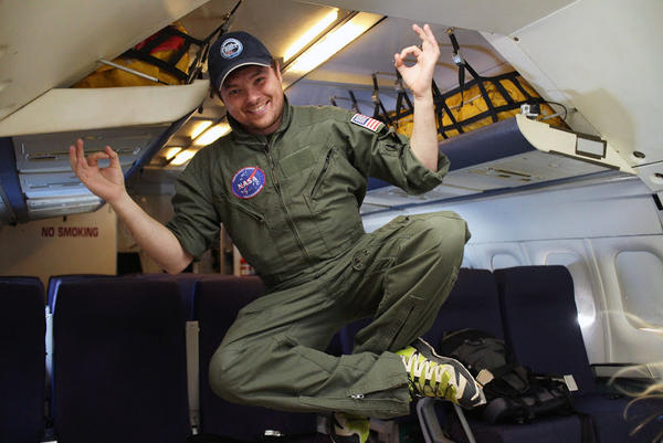 Dr. Justin Lawley, instructor in internal medicine at University of Texas Southwestern, floating in zero gravity.