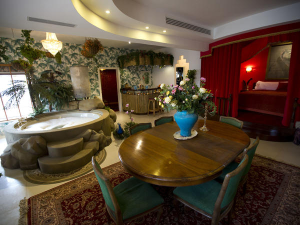 The presidential suite of The Walled Off Hotel is seen in a guesthouse that's now packed with the elusive artist Banksy's work.