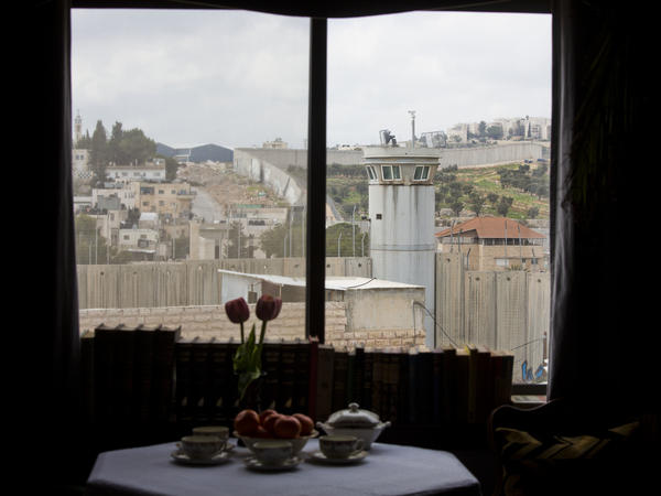 "The Walled Off Hotel, which offers what it calls the ""worst view in the world,"" has rooms that look onto an Israeli security barrier in the West Bank city of Bethlehem."