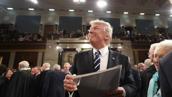 President Trump signs an autograph on his way out after delivering his first address to a joint session of Congress on Tuesday night.