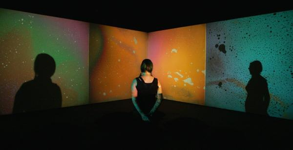 A woman looks at Metzger's <em>Liquid Crystal Environment</em>, part of a 2009 retrospective of his work at London's Serpentine Gallery.
