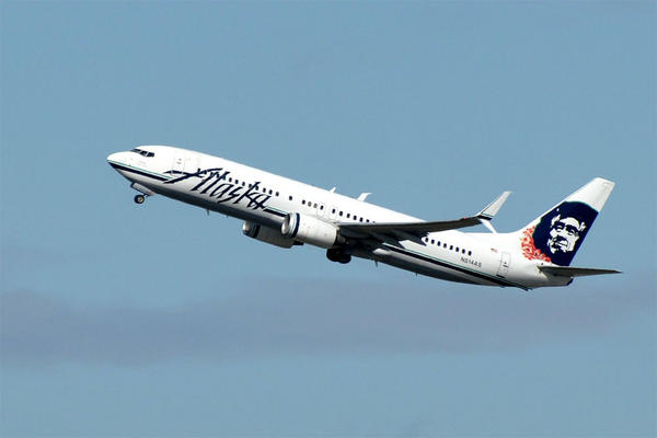 File photo of an Alaska AIrlines B737 taking off from SeaTac Airport. The FAA says reports of unsafe flying by civilian drones is on the rise.