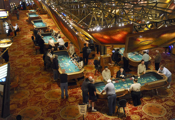 Patrons play craps at tables at Mohegan Sun in Uncasville, Conn.