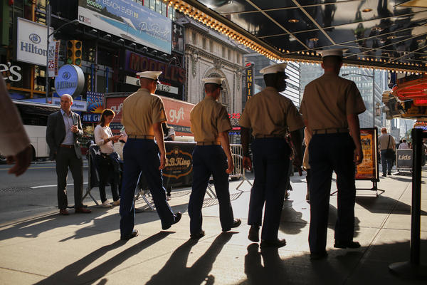 Marines walk around Times Square during Fleet Week in New York City last year. A Pentagon investigation is underway into the posting of hundreds, and perhaps thousands, of nude photos of female Marines.