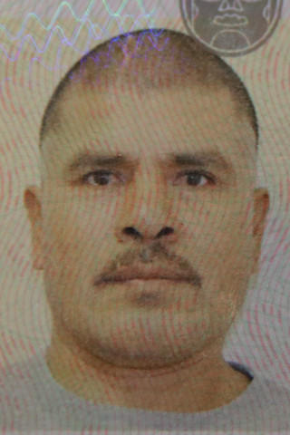 <p>Zaragoza-Sanchez in a 2015 passport photo</p>