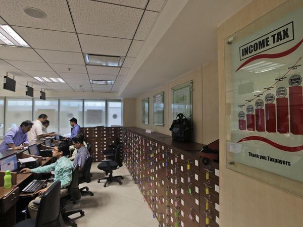 Salaried employees file their income tax papers at an tax office in New Delhi in 2013. Many Indians, including the entire agricultural sector and those living on less than $3,700 a year, are exempt from income tax. The Finance Ministry says just 27 million Indians paid income tax last year.