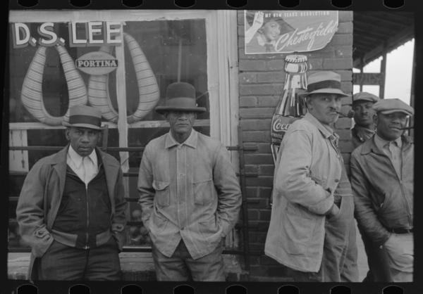 Folks in front of a general store in Mound Bayou, 1939.