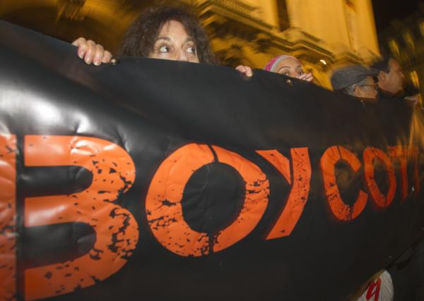 French demonstrators and supporters of Palestinians call for a boycott during a 2012 demonstration in Paris.