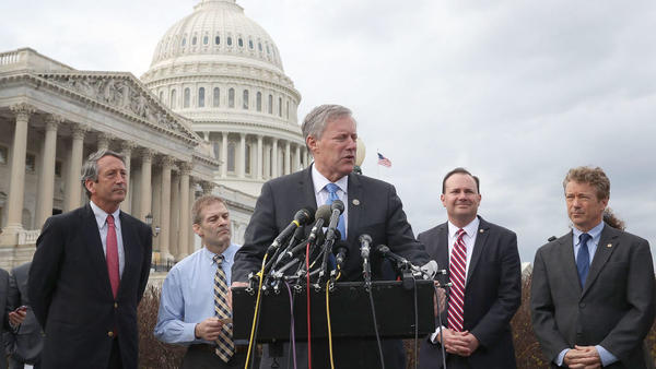 Rep. Mark Meadows, R-N.C., chairman of the House Freedom Caucus, speaks out Tuesday against the GOP leadership's plan to repeal and replace the Affordable Care Act, flanked by fellow Republican Reps. Mark Sanford of South Carolina (from left) and Jim Jordan of Ohio as well as Republican Sens. Mike Lee of Utah and Rand Paul of Kentucky.