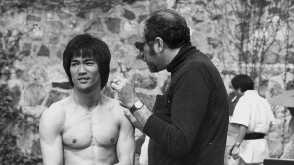 Actor Bruce Lee with producer Fred Weintraub, on the set <em>Enter the Dragon</em> in 1973.