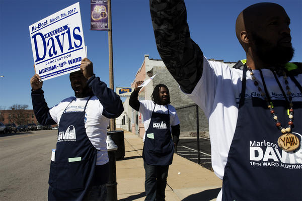 Campaign workers encourage passers-by to vote for 19th Ward incumbent Marlene Davis.