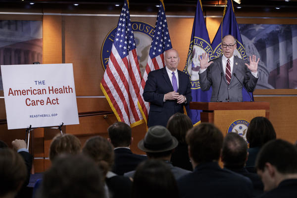 House Ways and Means Committee Chairman Rep. Kevin Brady, R-Texas listens at left as House Energy and Commerce Committee Chairman Rep. Greg Walden, R-Ore., speaks on Capitol Hill in Washington. (J. Scott Applewhite/AP)