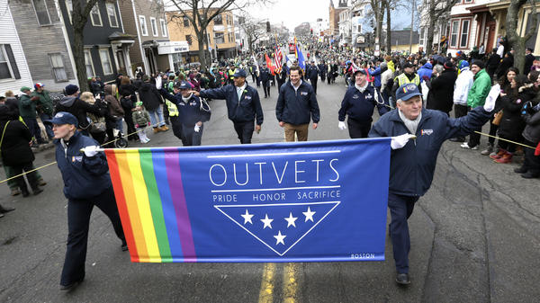 U.S. Rep. Seth Moulton, D-Mass., (center without hat) marches with members of OutVets, a group of LGBTQ military veterans, during the 2015 St. Patrick's Day parade in Boston.