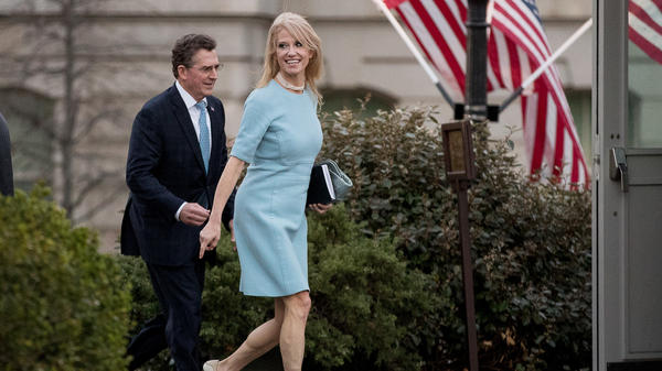 Counselor to the President Kellyanne Conway (right) and former Sen. Jim DeMint, now president of the Heritage Foundation, walk away from the West Wing of the White House on Wednesday. The White House declined to discipline Conway for a lapse in a recent on-air interview, rebuffing the Office of Government Ethics.