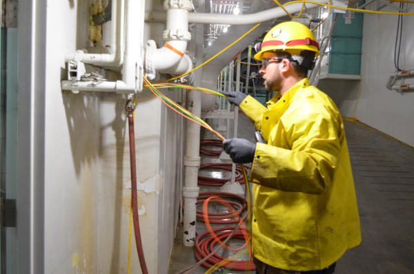 <p>A worker repairs the electrical system following a malfunction at the West Point Wastewater Treatment Plant.</p>