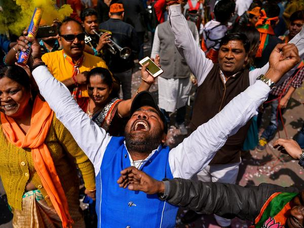 Supporters of India's Bhartiya Janata Party (BJP) celebrate election results outside the party headquarters in New Delhi on Saturday.
