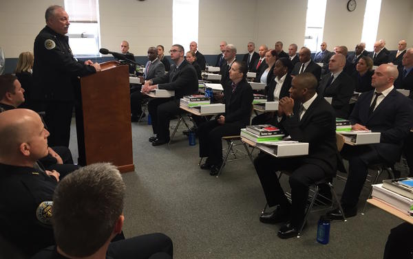 Chief of Police Steve Anderson speaks to a class of new recruits at the Metro Nashville police academy in January. The textbook Tactical Edge tops their stack of academy-issued reading.