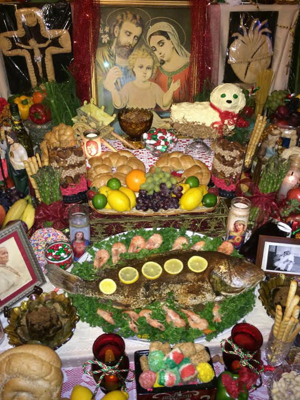 The Vaccarella family's altar to St. Joseph is a grandiose three-tiered shrine decorated with traditional foods, religious symbols and photos of loved ones.