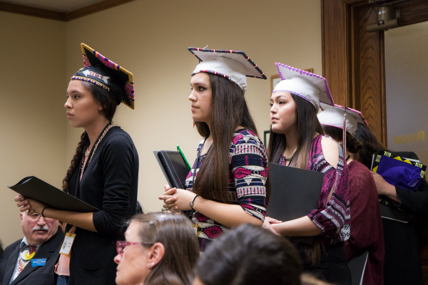 High school seniors Jessica Not Afraid, left, Georgeline Morsette and Shaylee St. Marks wear  their beaded graduation caps to support Senate Bill 319 at the Montana Legislature Tuesday,  March 14.
