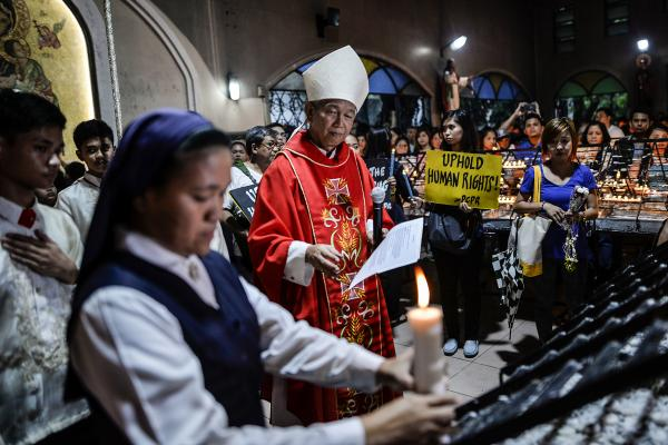 Philippine Catholic bishop Broderick Pabillo leads a vigil for victims of extrajudicial killings at a church in Manila in August 2016. The country's Catholic Bishops' Conference has issued a rare pastoral letter condemning President Rodrigo Duterte's bloody war on drugs, which has killed some 7,500 people since last June.