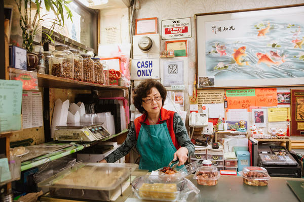 """Sau Ling, owner of Lucky Creation, photographed as part of Andria Lo's work from the """"Eat Chinatown"""" exhibit."""