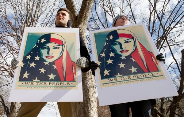 On March 11, Demonstrators gather near The White House to protest President Donald Trump's travel ban on six Muslim countries.