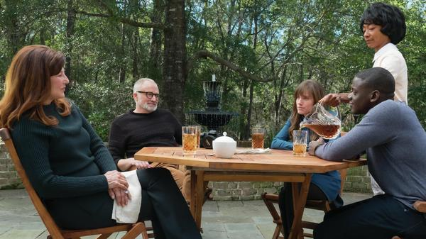 Chris sits down for tea with Rose's parents in <em>Get Out</em>. (From left, Catherine Keener, Bradley Whitford, Allison Williams, Betty Gabriel and Daniel Kaluuya).