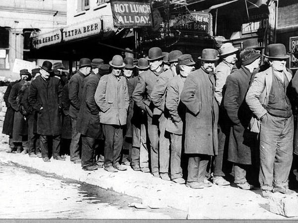 "A bread line forms outside of the Rescue Society in New York City in 1929. ""Brother, Can You Spare a Dime?"" directly confronted the hardship of the Great Depression."