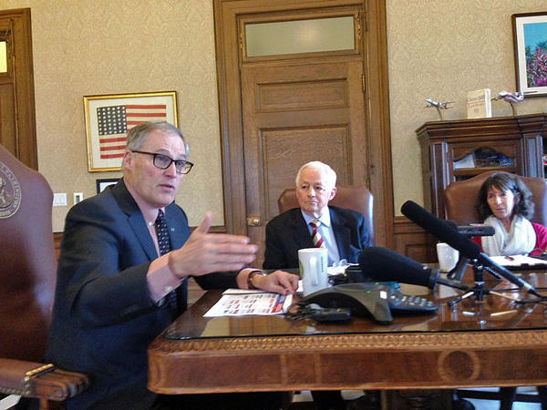Washington Gov. Jay Inslee, left, with Insurance Commissioner Mike Kreidler, calls the Republican-backed American Health Care Act a 'disaster for Washington'.