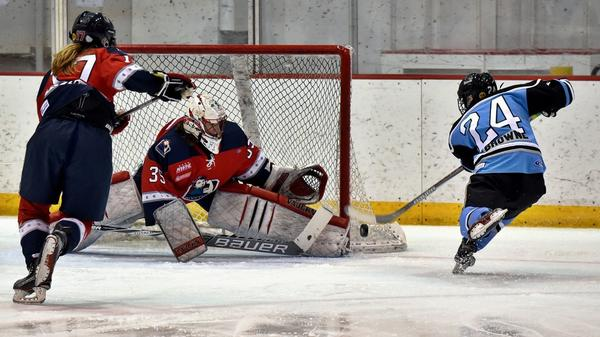 Harrison Browne shoots during a Buffalo Beauts match.