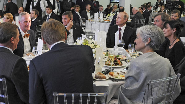 Russian President Vladimir Putin (center right) sits next to retired U.S. Lt. Gen. Michael T. Flynn (center left), who later became President Trump's national security adviser, at a December 2015 dinner in Moscow.