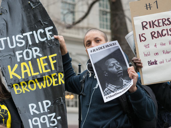 A confederacy of prison reform activists rallied at City Hall in New York City to demand that it close the long-controversial Rikers Island Corrections facility where, among others, Kalief Browder, died; critics maintain that the prison is unsafe and prolonged detention of inmates at the facility is a violation of Constitutional due process rights.