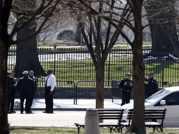 US Secret Service officers stand in the cordoned off area on Pennsylvania Avenue after a security incident near the fence of the White House Saturday. (AP Photo/Alex Brandon)
