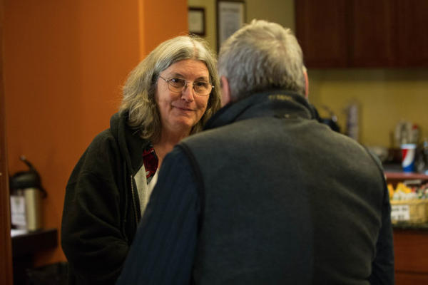 <p>An OPB member chats with Steve Amen in the lobby of the Tower Theatre in Bend, Oregon, Friday, March 17, 2017.</p>