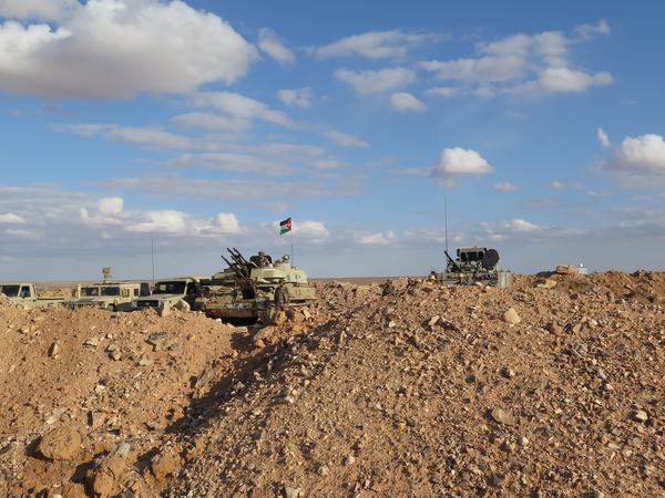 Jordanian tanks are stationed near a U.N.-funded clinic close to the border with Syria.