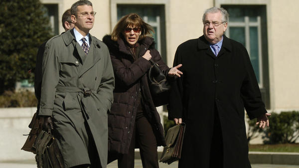 Former <em>New York Times</em> journalist Judith Miller along with her legal team including Robert Bennett, right, leaves U.S. District Court in Washington in 2007. Miller was jailed for nearly three months after refusing to testify in a CIA leak investigation.