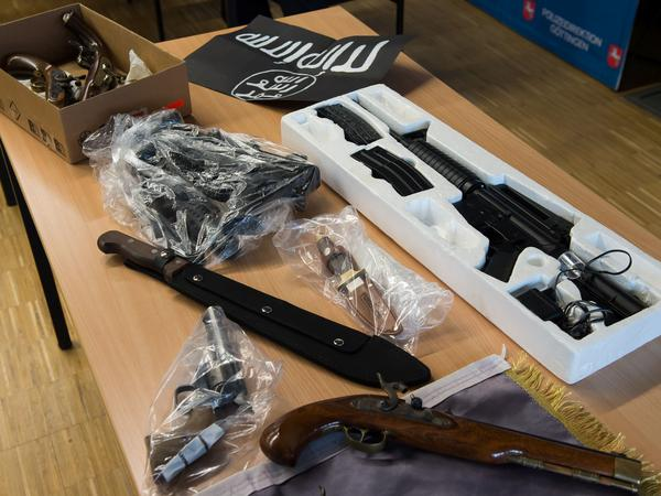 When two men who were born in Germany but whose families are from Algeria and Nigeria were arrested on terrorism charges in February, police displayed items seized in a raid.