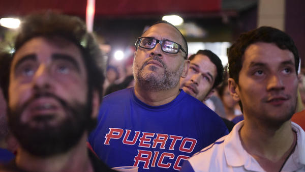 Fans gather Wednesday in the street in San Juan, Puerto Rico, to watch the World Baseball Classic final match between Puerto Rico and the United States. Puerto Rico's team reached the final game of the tournament undefeated.