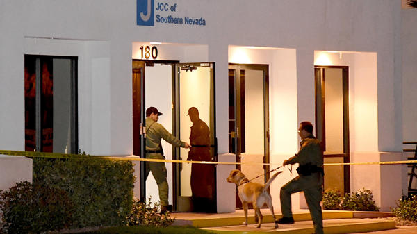 Las Vegas Metropolitan Police Department K-9 officers search the Jewish Community Center of Southern Nevada after an employee received a suspicious phone call that led to the evacuation of about 10 people from the building on Feb. 27. A suspect in Israel has been arrested in connection with the waves of bomb threats like this one.