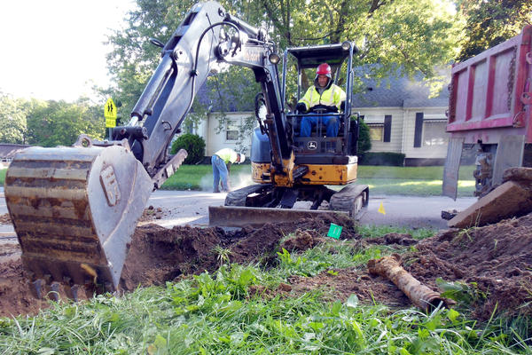 Crews in Flint work to replace a lead service line.