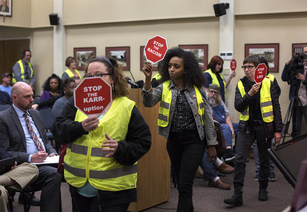 Residents and activists pressure Ferguson's City Council members to agree to the Department of Justice's proposed consent decree during a public forum on the decree in March of 2016.