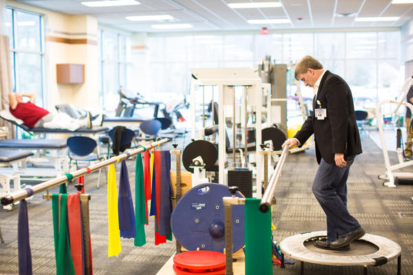 CEO Virgil Underwood performs physical therapy exercises at the new Boone Memorial Hospital