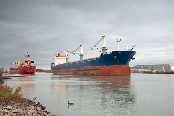 Two bulk carriers passing at the exit of Lock 1 on the Welland Canal.
