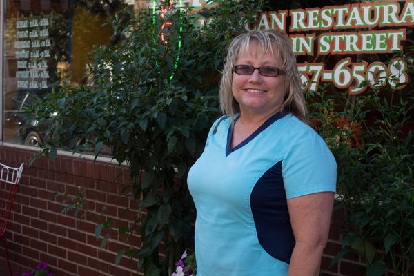 Penny Hart stands in front of a restaurant in Point Pleasant, WV.