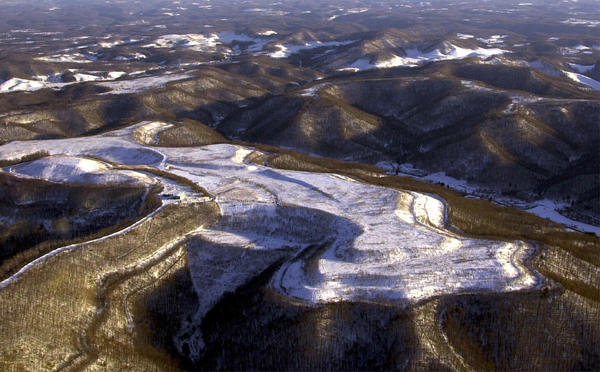 Mountains near Kayford, W.Va., seen in this Jan. 2, 2000 file photo, show how mountaintop removal mining has flattened many mountain peaks.